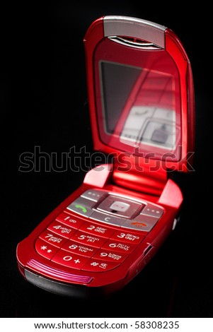 Red cell phone over black - stock photo