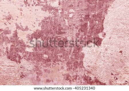 Red cement wall with traces of crumbling plaster. textural composition - stock photo