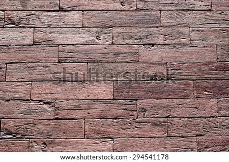 Red ceramic slabs imitating wood on wall closeup - stock photo