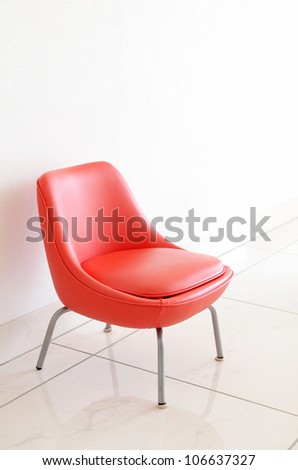 Red Chair to face a blank wall