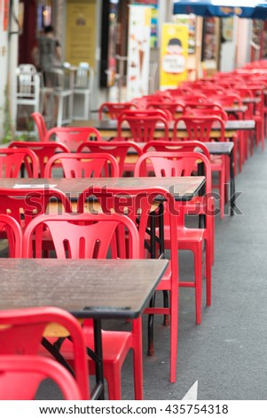 Red chairs and dining table. For eating in front of a store in Chinatown. - stock photo
