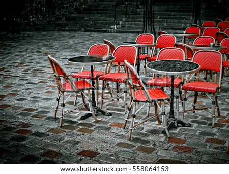Red Chairs At A Restaurant Terrace In The Street In Paris