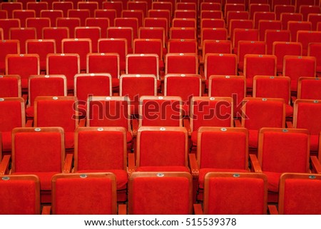 red chairs for the audience in the cinema or theater