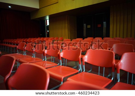 Red chairs in meeting room