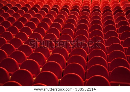 Red chairs in rows at empty Theater