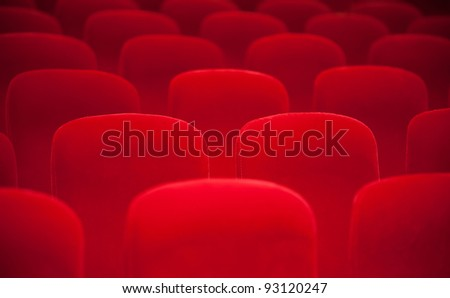 Red chairs in the empty auditorium