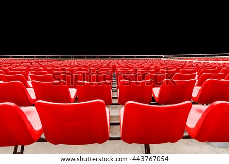 Red chairs on a black background