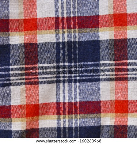 red checked fabric abstract texture. - stock photo