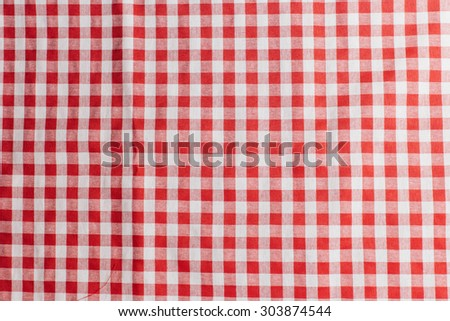 Red checkered tablecloth texture background - stock photo