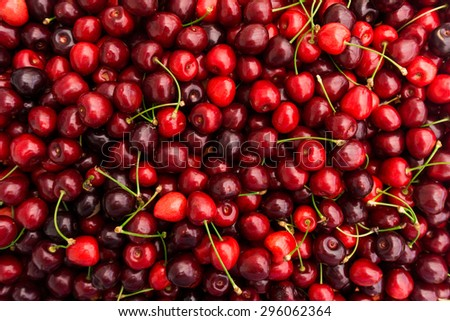Red Cherries.   Cherry selection.  Background of ripe cherries - stock photo