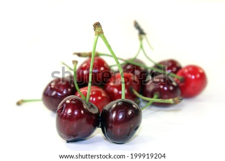 red cherries on a white background - stock photo