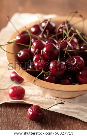 red cherry in a wood bowl - stock photo