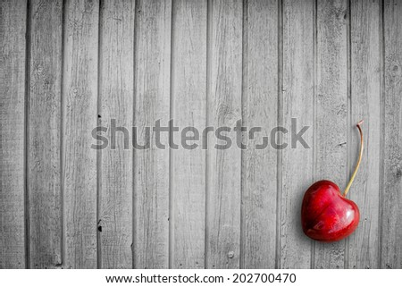Red cherry on a wooden background - stock photo