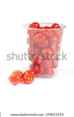 Red cherry tomatoes in plastic packaging on the light background - stock photo