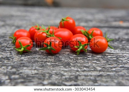 Red cherry tomatoes on table. Healthy living, organic food, freshness concept. Red vegetables.  - stock photo