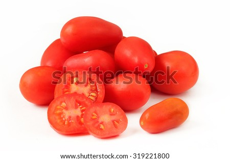Red cherry tomatoes pear-shape form isolated on white - stock photo