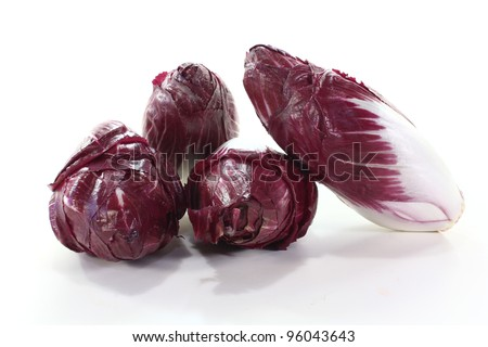 red chicory salads on a light background