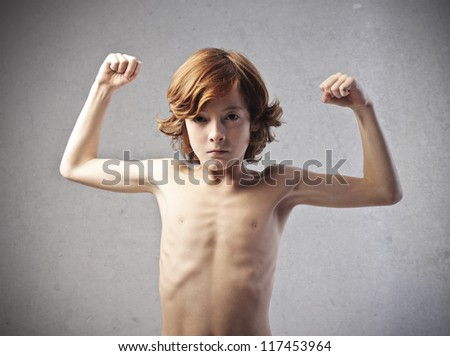 Red child flexes his muscles