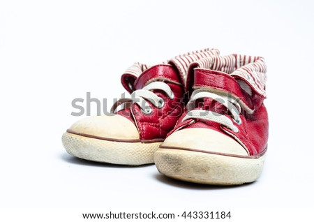 red children's leather shoes on a white background ,old sneaker