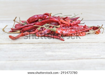 Red chili dried on wood table. Ingredient of food. - stock photo