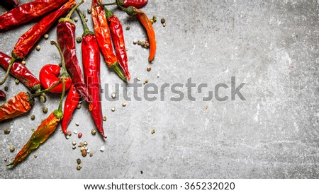 Red chili pepper dried. On a stone background. Free space for text . Top view - stock photo