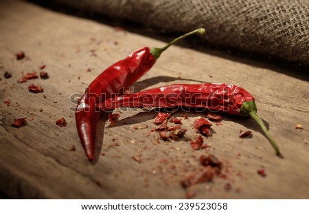 Red chili pepper on a woden table - stock photo