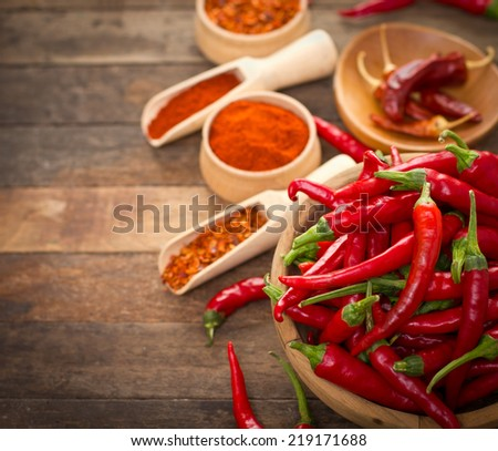 Red chili peppers and spices on the table - stock photo