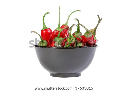 Red chili peppers in a black bowl isolated