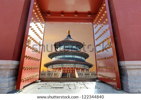 Red Chinese gate opening to a Chinese building in sunset light ( Temple of Heaven or Tiantan Temple in Beijing - China ) - stock photo