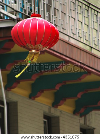 Red chinese lamp hanging on a balcony in China Town - stock photo