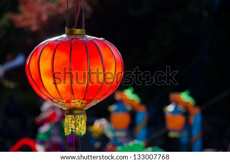 Red chinese lantern on dark background - stock photo