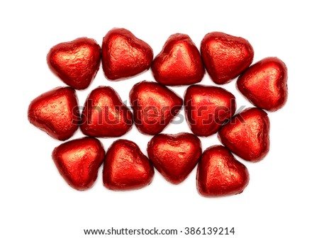 Red chocolate hearts isolated on white - stock photo