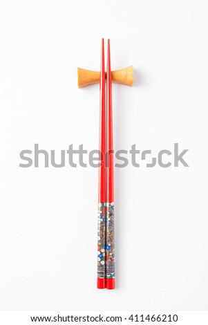 Red chopsticks, isolated on white background. - stock photo