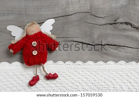 Red Christmas angel on grey wooden background - stock photo