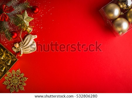 Red Christmas background with decorated fir tree and angel