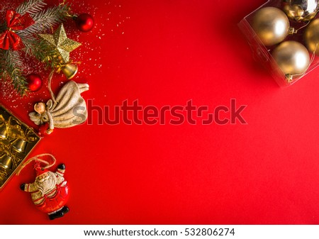 Red Christmas background with decorated fir tree and Santa and angel