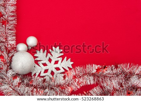 Red Christmas background with tinsel and Christmas decorations