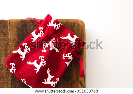 Red christmas bag on wood with white background