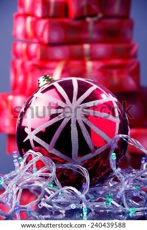 red Christmas ball, Christmas lights, red Christmas gift boxes  - stock photo