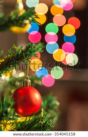 Red christmas ball decoration agains bokeh light background - stock photo