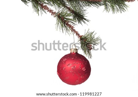 Red Christmas ball hanging from a Christmas tree