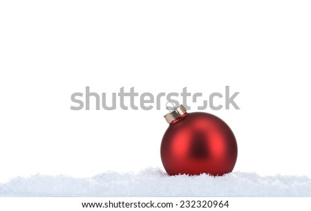 red christmas ball lying on snow - stock photo