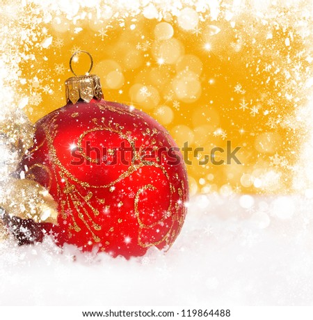 Red christmas ball on gold background with space for text
