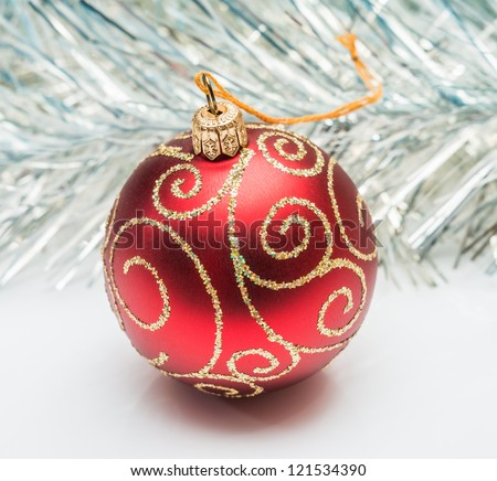 red Christmas ball ornaments on a background tinsel - stock photo