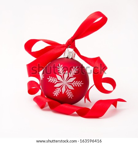 Red christmas ball with curly ribbon