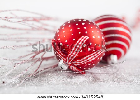 Red Christmas balls and decorations on white background