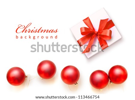 Red Christmas balls and white gift with red ribbon bow, isolated on white background - stock photo
