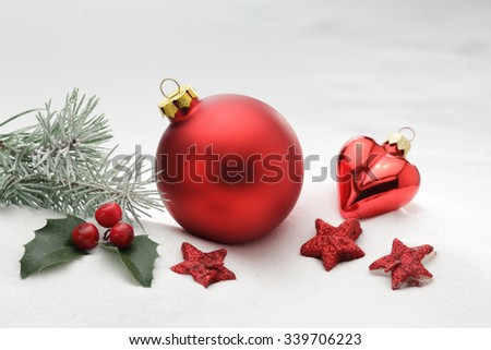 Red Christmas balls decoration/ christmas tree branch/ snow background/ isolated on white background