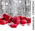 red christmas balls in snowed  winter forest - stock photo