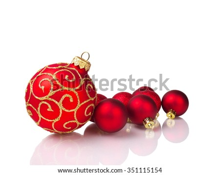 red christmas balls, isolated on white background, shallow depth of field - stock photo
